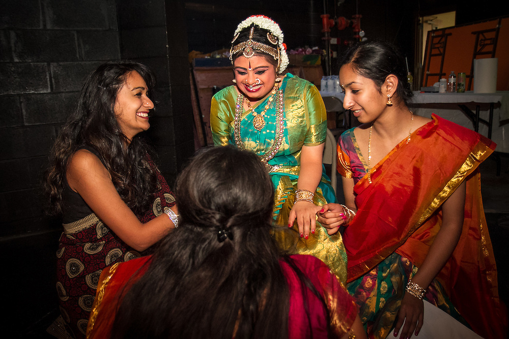 Lincroft, New Jersey, 9/20/14: Raga Suresh (left) and Malvika Patrachari (right) support Hema Ramaswamy backstage before her arangetram. Raga and Malvika recently gave their own arangetram performances.