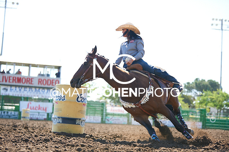 Barrel racer Kassidy Dennison of Tohatchi, NM competes at the Livermore Rodeo in Livermore, CA<br /> <br /> <br /> UNEDITED LOW-RES PREVIEW<br /> <br /> <br /> File shown may be an unedited low resolution version used as a proof only. All prints are 100% guaranteed for quality. Sizes 8x10+ come with a version for personal social media. I am currently not selling downloads for commercial/brand use.