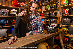 Fabrizio Caoduro and his wife in the cool 70's Helmets booth at the Motor Bike Expo. Verona, Italy. January 24, 2016.  Photography ©2016 Michael Lichter.