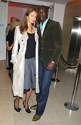 Fashion designer OZWALD BOATENG and his wife GYUNEL at a cocktail party hosted by MAC cosmetics to kick off London Fashion Week at The Hospital, 22 Endell Street London on 18th September 2005.At the event, top model Linda Evangelista presented Ken Livingston the Lord Mayor of London with a cheque for £100,000 in aid of the Loomba Trust that aims to privide education to orphaned children through a natural disaster or through HIV/AIDS.<br /><br />NON EXCLUSIVE - WORLD RIGHTS