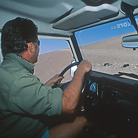 An Argentine driver navigates a dirt road on the  vast South American Altiplano.