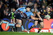 Brad Weber of the Chiefs is tackled by Lachlan Swinton of the Waratahs during the Round 5 Trans-Tasman Super Rugby match between NSW Waratahs and Waikato Chiefs at Brookvale Oval in Sydney, Saturday, June 12, 2021. (AAP Image/Dan Himbrechts) NO ARCHIVING, EDITORIAL USE ONLY