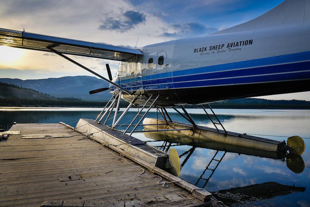 A Blacksheep Aviation Turbo Otter rests as the sun rises on Schwatka Lake, Yukon, Canada.