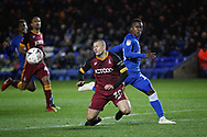 Bradford City defender Paul Caddis (38)  is fouled by Peterborough United midfielder Siriki Dembele (10) during  the The FA Cup 2nd round match between Peterborough United and Bradford City at London Road, Peterborough, England on 1 December 2018.
