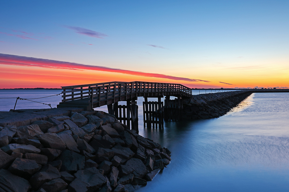 Seascape photography of the harbor jetty with its wooden bridge at dawn in Plymouth, MA. The town of Plymouth is most famous for its historic landmarks and sites such as Plymouth Rock, the Mayflower and Plimoth Plantation. <br /> <br /> Plymouth Massachusetts seascape fine art photography prints are available as museum quality photo prints, canvas prints, acrylic prints or metal prints. Prints may be framed and matted to the individual liking and interior design decorating ideas:<br /> <br /> https://juergen-roth.pixels.com/featured/plymouth-harbor-jetty-juergen-roth.html<br /> <br /> Good light and happy photo making!<br /> <br /> My best,<br /> <br /> Juergen<br /> Prints: http://www.rothgalleries.com<br /> Photo Blog: http://whereintheworldisjuergen.blogspot.com<br /> Instagram: https://www.instagram.com/rothgalleries<br /> Twitter: https://twitter.com/naturefineart<br /> Facebook: https://www.facebook.com/naturefineart