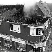 NLD/Huizen/19910721 - Uitgebrande pand kookwinkel DIMA Oude Raadhuisplein Huizen