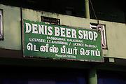 Close up Denis Beer Shop off licence sign, Pasikudah Bay, Eastern Province, Sri Lanka, Asia