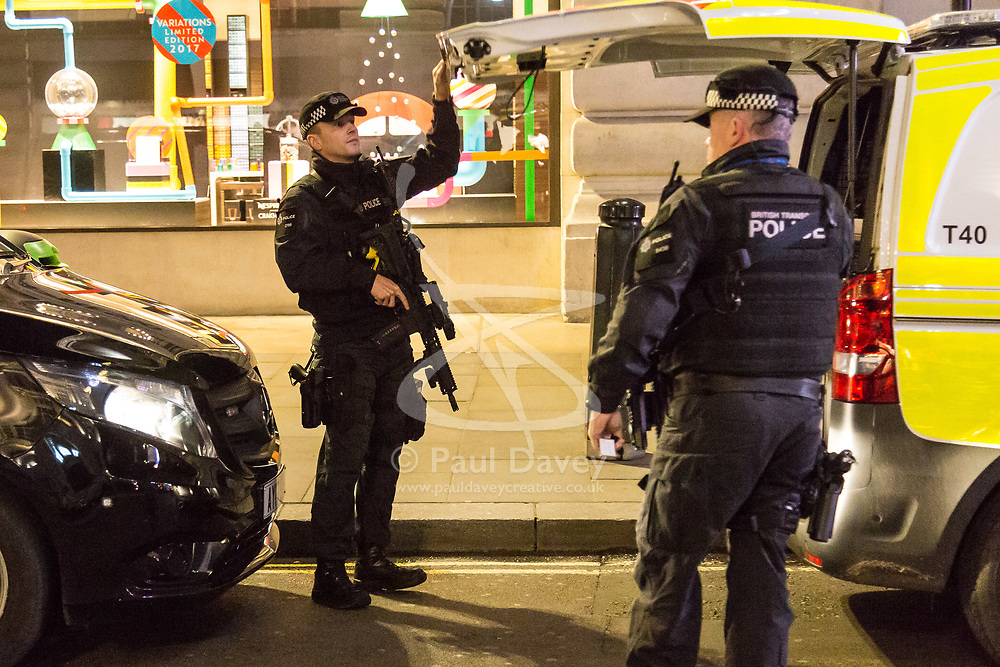 London, December 31 2017. Armed police on Regent Street prepare to go on patrol as revellers in London's West End enjoy the build-up to New Year. © SWNS