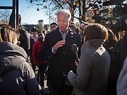 """04 DECEMBER 2019 - AMES, IOWA: Former Vice President JOE BIDEN talks to reporters at Iowa State University after his campaign event in Ames Wednesday. Vice President Biden is touring Iowa this week on his """"No Malarkey"""" bus tour. Iowa hosts the first presidential selection event of the 2020 election cycle. The Iowa caucuses are on February 3, 2020.      PHOTO BY JACK KURTZ"""