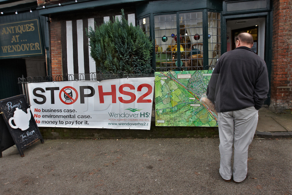 © Licensed to London News Pictures.  10/01/2012.WENDOVER, BUCKINGHAMSHIRE. A local business, just yards from the proposed route of the HS2 high speed train line, displays a sign protesting against the impact the construction and completed line is expected to have on the Chilterns and Wendover in particular. Photo credit :  Cliff Hide/LNP