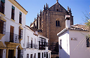 Cathedral church set amongst historic whitewashed houses in the old town of Ronda, Andalucia, Spain