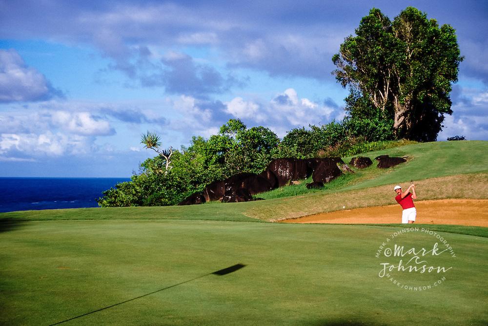 Kauai, Hawaii, USA --- Golfer in a bunker ****Model Release available
