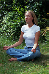 Jul. 26, 2012 - Girl meditating (Credit Image: © Image Source/ZUMAPRESS.com)