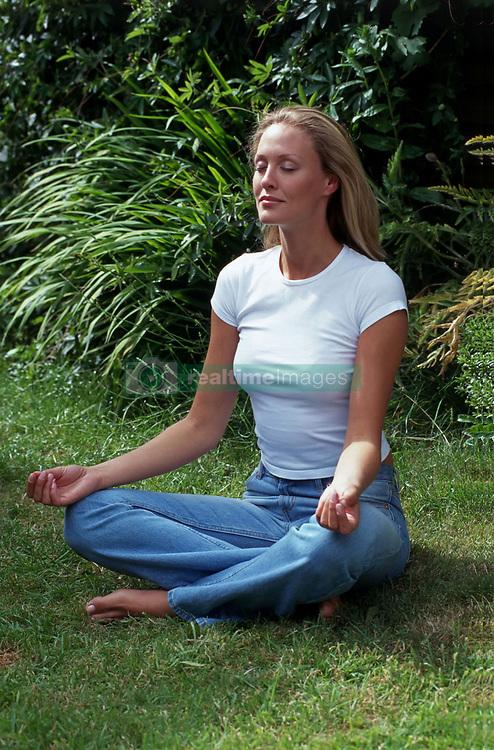 Jul. 26, 2012 - Girl meditating (Credit Image: © Image Source/ZUMAPRESS.com)
