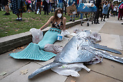 Extinction Rebellion activist mermaid at the Marine Rebellion march on 6th September 2020 in London, United Kingdom. Ocean Rebellion, Sea Life Extinction, Animal Rebellion and Extinction Rebellion joined together to celebrate the biodiversity found in our seas, and to grieve at the destruction of the Earth's oceans and marine life due to climate breakdown and human interference, and the loss of lives, homes and livelihoods from rising sea levels. Extinction Rebellion is a climate change group started in 2018 and has gained a huge following of people committed to peaceful protests. These protests are highlighting that the government is not doing enough to avoid catastrophic climate change and to demand the government take radical action to save the planet.
