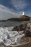 Waves across the beach at The Old Lighthouse at Ynys Llanddwyn, Newborough, Angelsey