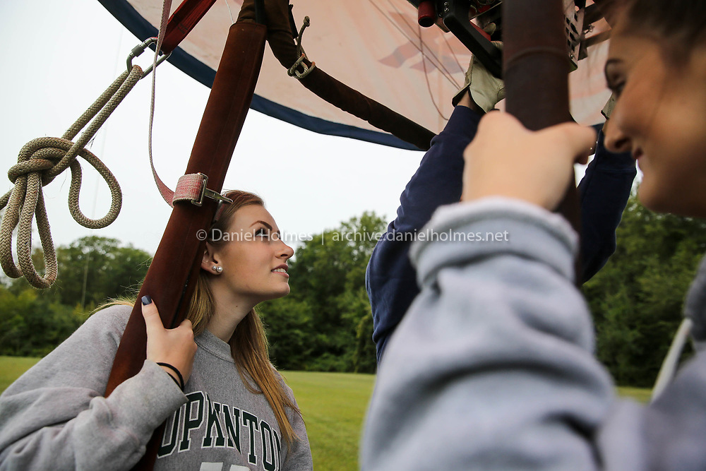 (8/29/17, HOPKINTON, MA) Hopkinton High juniors, Ivy Missaggia, left, and Alyssa Poisson go up in the REMAX hot air balloon during the Back to School Golf Ball Drop at Hopkins Elementary School in Hopkinton on Tuesday. [Daily News and Wicked Local Photo/Dan Holmes]