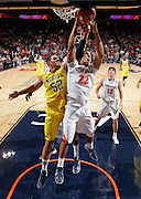 CHARLOTTESVILLE, VA- NOVEMBER 29: Malcolm Brogdon #22 of the Virginia Cavaliers reaches for the rebound with Jordan Morgan #52 of the Michigan Wolverines during the game on November 29, 2011 at the John Paul Jones Arena in Charlottesville, Virginia. Virginia defeated Michigan 70-58. (Photo by Andrew Shurtleff/Getty Images) *** Local Caption *** Jordan Morgan;Malcolm Brogdon