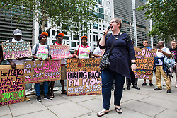 London, UK. 10 July, 2019. Karen Doyle of Movement for Justice addresses fellow campaigners at a protest outside the Home Office against the government department's decision to try to block the return to the UK of PN, a Ugandan lesbian removed from the UK using the now unlawful fast track procedure in 2013 but who the High Court ordered on 24th June must be returned to the UK by the Home Office after the handling of her case was ruled to be 'procedurally unfair'.