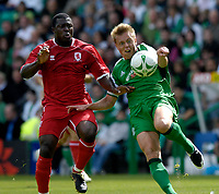 Photo: Jed Wee/Sportsbeat Images.<br /> Hibernian v Middlesbrough. Pre Season Friendly. 28/07/2007.<br /> <br /> Hibs' Torben Joneleit (R) tries to clear the ball from Middlesbrough's Yakubu.
