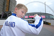 a young England fan posing for a photo outside Wembley Stadium before k/o. FIFA World cup qualifying match, european group F, England v Malta at Wembley Stadium in London on Saturday 8th October 2016.<br /> pic by John Patrick Fletcher, Andrew Orchard sports photography.