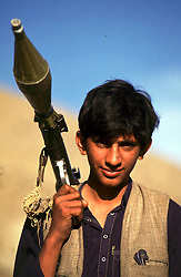 1995. Jalalabad, Afghanistan. .A 16 year old Pashtun Mujahideen aligned with Gulbuddin Hekmatyar's rebel group Hezb-e Islami prepares for battle. With the country in the grip of total anarchy, word on the street has it that a new group, the Taliban are making preparations to take control of the volatile country. .Photo; Charlie Varley