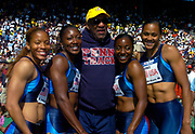 The USA Red women's 4 x 200-meter relay team (from left) of LaTasha Collander, Chryste Gaines, Inger Miller and Marion Jones on the awards podium with Bill Cosby (center) at the 110th Penn Relays at  the University of Pennsylvania's Franklin Field on Saturday, April 24, 2004 in Philadelphia.