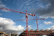 Large cranes operating at construction site of new arc shopping centre on the site of the old cattle market, Bury St Edmunds, Suffolk, England - October 2008