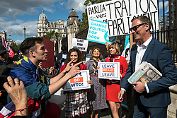 © Licensed to London News Pictures. 04/09/2019. London, UK. Brexit Party MEP MARTIN DAUBNEY (R) has a heated discussion with a pro EU supporters (L) outside the Houses of Parliament in Westminster, London. British Prime Minister Boris Johnson has a called for a general election after losing his first commons vote and losing his majority, removing his control of parliament. Photo credit: Ben Cawthra/LNP
