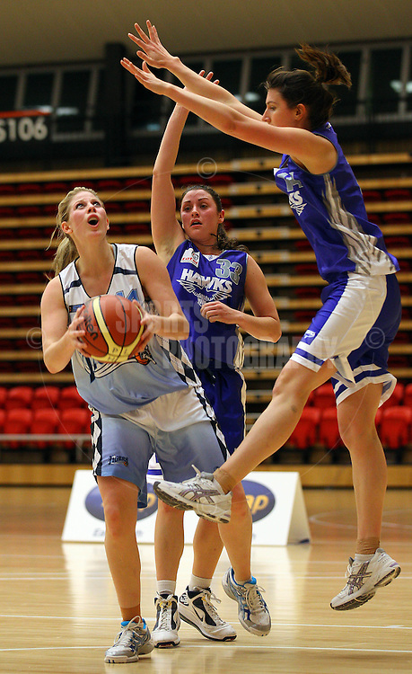 PERTH, AUSTRALIA - JULY 16: Melissa Marsh of the Tigers looks to score against Gabby Clayton and Chelsea Boyanich of the Hawks during the week 18 SBL game between the Perry Lakes Hawks and the Willetton TIgers at The State Basketball Center on July 16, 2011 in Perth, Australia.  (Photo by Paul Kane/All Sports Photography)