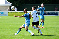Kane Wilson (2) of Forest Green Rovers battles for possession with Karenll Chambers (9) of Yate Town during the Pre-Season Friendly match between Yate Town and Forest Green Rovers at the Jelf Stadium, Yate, United Kingdom on 17 July 2021.
