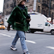 Girl walking in the street during winter.