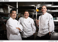Three Canlis chefs in kitchen.