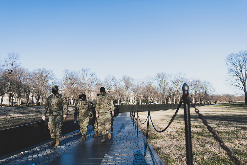 Washington DC, USA - January 22, 2021: Soldiers of the 76th Infantry Brigade Combat Team, part of the Indiana National Guard, visit the Vietnam Veterans Memorial. They were in Washington DC, along with 25,000 other National Guard men and women, as part of the security operation surrounding the Presidential Inauguration.