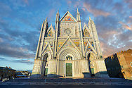 14th century Tuscan Gothic style facade of the Cathedral of Orvieto at sunset, designed by Maitani, Umbria, Italy .<br /> <br /> Visit our ITALY HISTORIC PLACES PHOTO COLLECTION for more   photos of Italy to download or buy as prints https://funkystock.photoshelter.com/gallery-collection/2b-Pictures-Images-of-Italy-Photos-of-Italian-Historic-Landmark-Sites/C0000qxA2zGFjd_k<br /> .<br /> <br /> Visit our MEDIEVAL PHOTO COLLECTIONS for more   photos  to download or buy as prints https://funkystock.photoshelter.com/gallery-collection/Medieval-Middle-Ages-Historic-Places-Arcaeological-Sites-Pictures-Images-of/C0000B5ZA54_WD0s