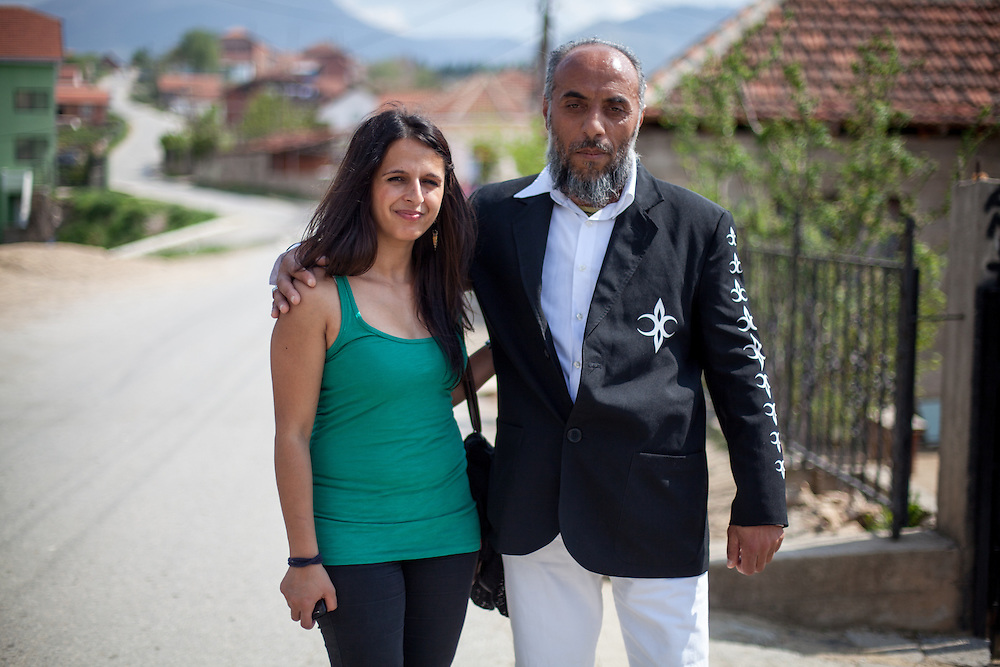 Romina Kajtazova - working as a paralegal for NGO Kham - getting a portrait with a man from the local Roma community during the European Immunization Week in the city of Vinica in Macedonia.