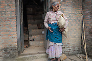 Devastating April 2015 Nepal Earthquake. Kirtipur Municipality, Kathmandu Valley. A woman in distress after the roof of her house has collapsed.