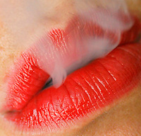 Woman's mouth with smoke