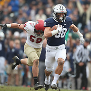 NEW HAVEN, CONNECTICUT - NOVEMBER 18: JP Shohfi #88 of Yale makes a break while challenged by Joey Goodman #59 of Harvard during the Yale V Harvard, Ivy League Football match at the Yale Bowl. Yale won the game 24-3 to win their first outright league title since 1980. The game was the 134th meeting between Harvard and Yale, a historic rivalry that dates back to 1875. New Haven, Connecticut. 18th November 2017. (Photo by Tim Clayton/Corbis via Getty Images)