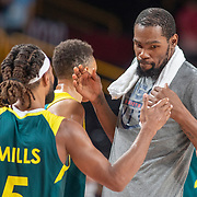 TOKYO, JAPAN August 5: Patty Mills #5 of Team Australiaand Kevin Durant #7 of Team United States embrace at the end of the game during the Australia V USA semi final basketball match for men at the Saitama Super Arena during the Tokyo 2020 Summer Olympic Games on August 5, 2021 in Tokyo, Japan. (Photo by Tim Clayton/Corbis via Getty Images)
