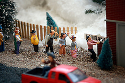 03 January 2014. Metairie, Louisiana. <br /> Lakeside Mall. A potentially controversial/satirical Christmas display is part of the main festive attraction at the mall created by local designer Frank Evans. Part of the display, (complete with a miniature train ridden by children) features an 'Affordable Health Care Hospital.' Standing in line are model customers apparently holding out paperwork, possibly health care bills. Also included is a hearse, coffin, corpse and a strange looking man in a bright orange jump suit along with what would appear to be a migrant worker wearing a sombrero sitting in the back of a pickup truck. Evans was also responsible for a fairly controversial display in 2005 following hurricane Katrina.<br /> Photo; Charlie Varley/varleypix.com