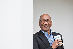 Businessman smiling African Coffee to go happy