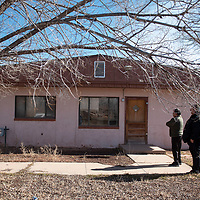 Jerome Haskie, left, Zuni Public School District Board of Education vice-president and Mark Archuleta, director of support services at Zuni Public School District look at a unit at the Dowa Yalanne Teacherage Thursday, Jan. 30 in Zuni Pueblo.