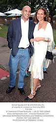 Social figures GUY & ANDREA DELLAL, at a party in London on 2nd July 2003.<br />  PLB 284