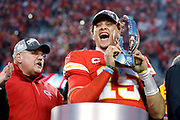 Kansas City Chiefs head coach Andy Reid watches as quarterback Patrick Mahomes holds the Lamar Hunt Trophy as they celebrate winning the NFL AFC Championship football game against the Tennessee Titans, Sunday, Jan. 19, 2020, in Kansas City, MO. The Chiefs won 35-24 to advance to Super Bowl 54. (Photo/Colin E. Braley)