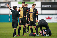 Football - 2020 / 2021 FA Trophy - Round Two - Marine vs Hyde United - Rossett Park<br /> <br /> Marine FC's Neil Kengni receives treatment following a oil while team mates remonstrate with Referee Neil Evans<br /> <br /> <br /> <br /> COLORSPORT/TERRY DONNELLY