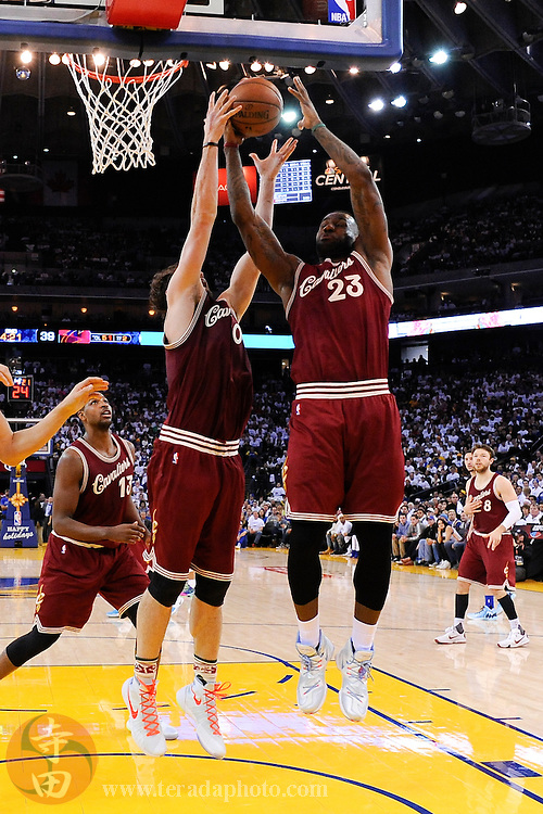 December 25, 2015; Oakland, CA, USA; Cleveland Cavaliers forward LeBron James (23) grabs a rebound during the second quarter in a NBA basketball game on Christmas against the Golden State Warriors at Oracle Arena. The Warriors defeated the Cavaliers 89-83.