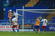 George Lapslie of Mansfield Town (32) wins a header  during the The FA Cup match between Mansfield Town and Dagenham and Redbridge at the One Call Stadium, Mansfield, England on 29 November 2020.