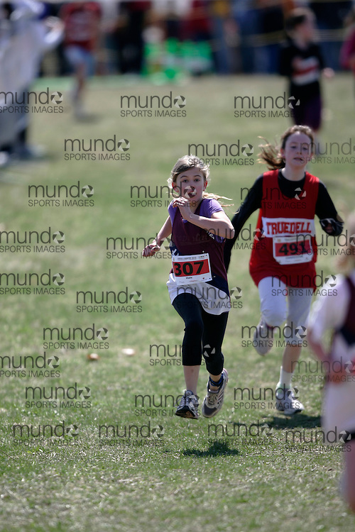 (Kingston, Canada---11 April 2010) Aimee Hale (#307) of Lancaster Drive PS runs in the Elementary Girls race at the 17th World University Cross Country Championships (FISU) held on the Fort Henry Hill course in Kingston, Ontario, Canada. .Geoff Robins/ Mundo Sport Images..This photograph is Copyright Geoff Robins / Mundo Sport Images, 2010. For information, go to www.mundosportimages.com or contact info@mundosportimages.com.