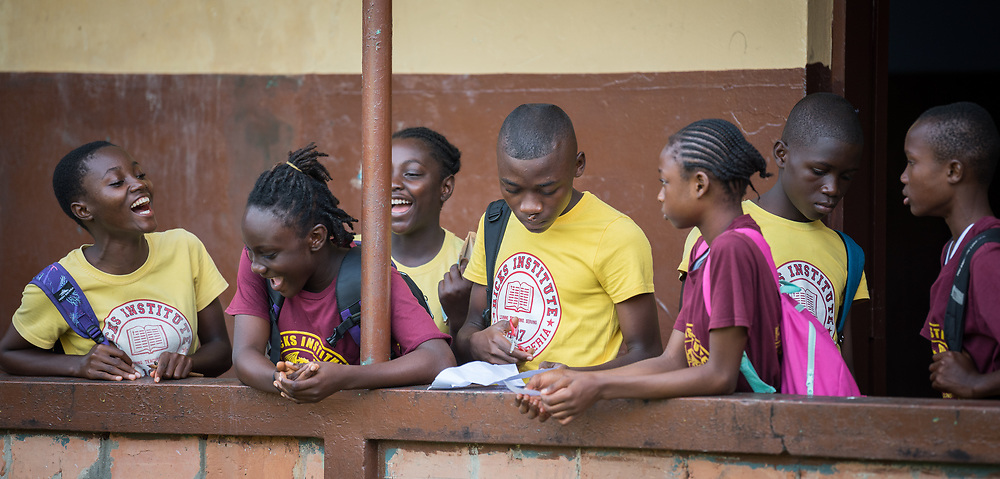 4 November 2019, Vriginia, Liberia: Students interact on a balcony section of Ricks Institute. The Liberia Baptist Convention runs Ricks Institute, a day and boarding school for currently 496 students from kindergarten up through 12th grade.